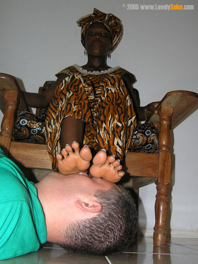 Under the soles of African native Lady