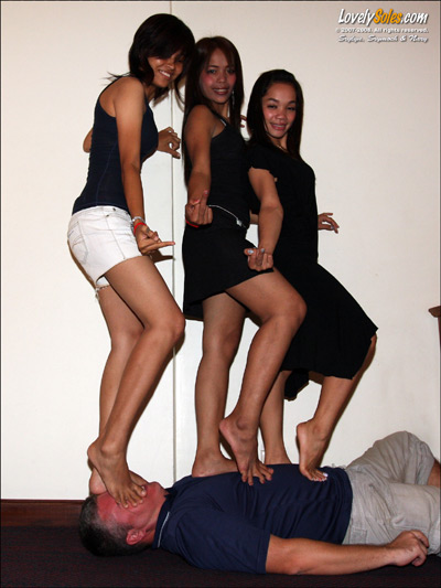 Under the weight of 3 happy Asian girls