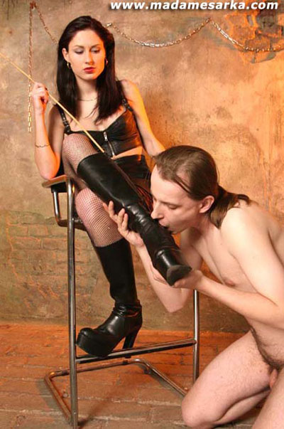 Showing his affection kissing the boots of Madame Sarka