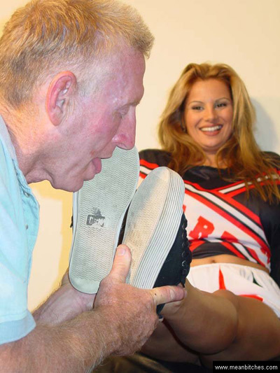 Cheerleader amused at her slave tasting the dirt on her sneakers