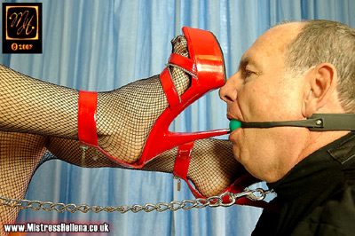 Playing with the gag on her slave's mouth