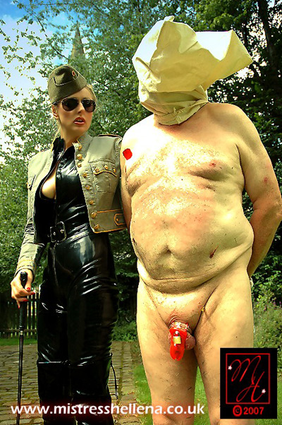 Officer Hellena brings her chastitised slave for public punishment