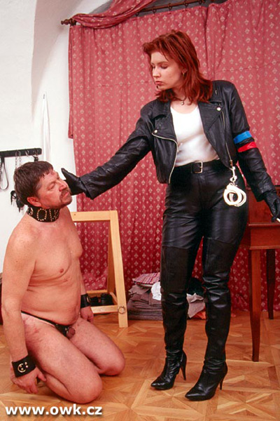 Prison slave getting a face slap from the guard
