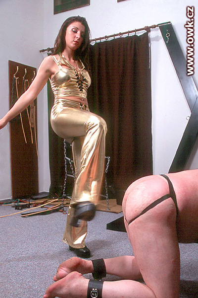 Madame Loreen kicks at her slave