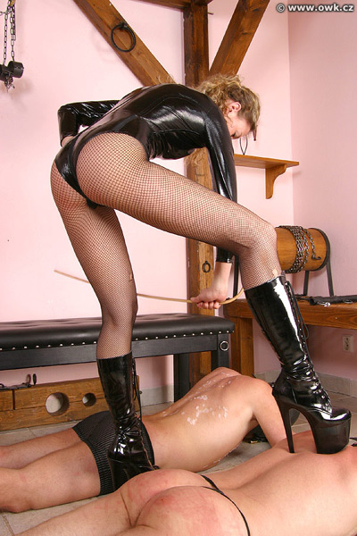 Caning off her wax on her slaves