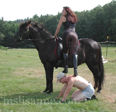 On his knees to serve as her horse mount