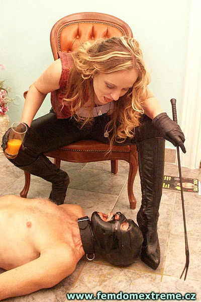 Madame Christine is feeding some orange juice to her slave from her mouth