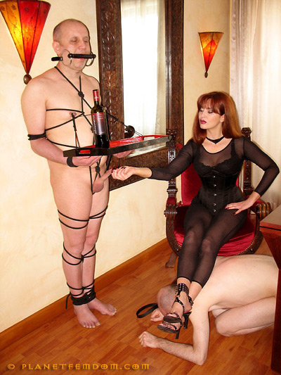 Training her slaves to serve her