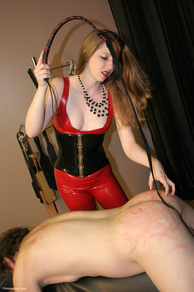 Princess Kali examining the whipping she just dished out