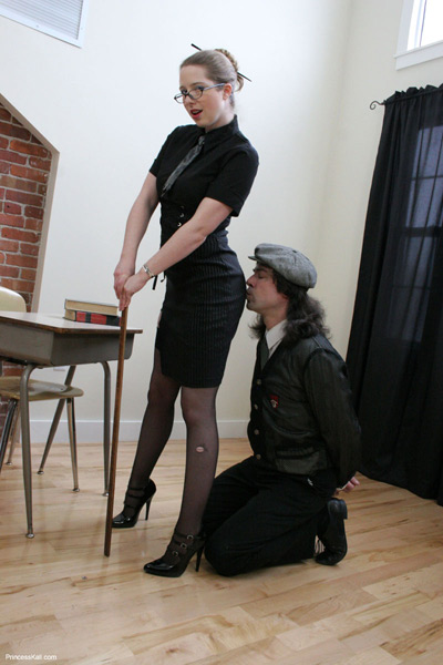 Kissing on the ass of the strict disciplinarian