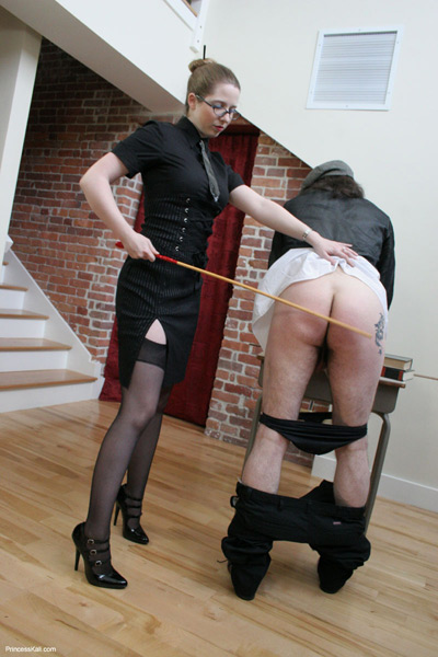 Princess Kali caning her student