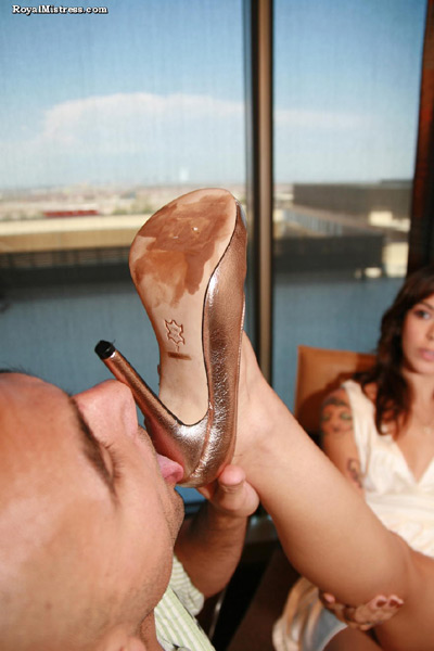 Kayla gets her expensive heels licked clean by the hotel bell boy