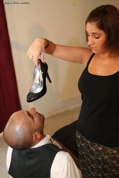 Mistress Amelia shows her butler her shoes aren't clean enough