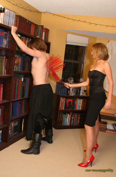 Flogging her house keeping slave