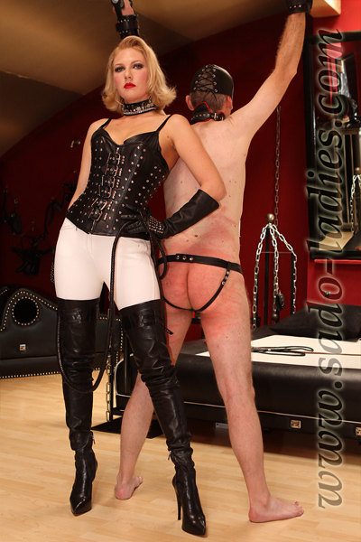 Showing off the results of her whipping works