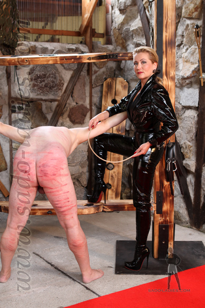 Cruel caning at the rack
