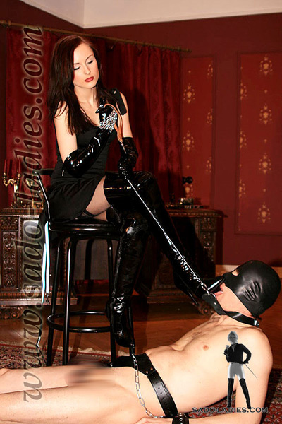 Licking Miss Leni's expensive boots clean