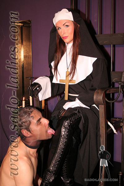 The perverted nun makes her worshipper lick on her boots