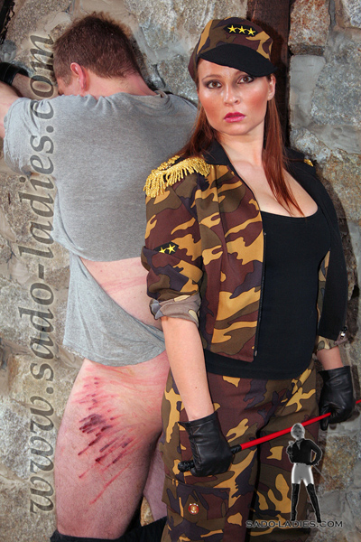 Army Mistress showing off her works on the rebel prisoner