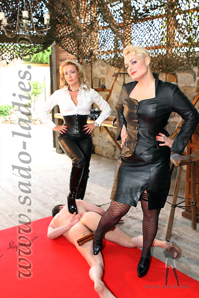 Chastity slave submits to the leather Mistresses