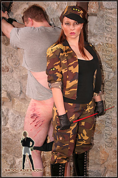 Lady Lilith shows off the results of her whipping strokes