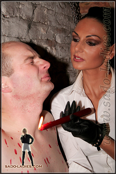 Sadistic Mistress drips hot wax onto her slave