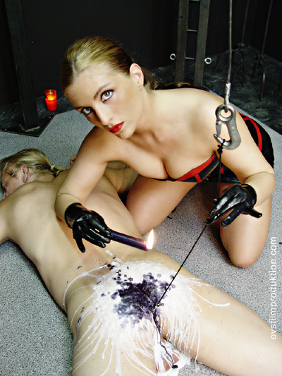 Candle and wax torture experiment on her slave