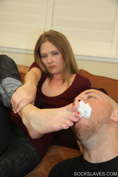 Mistress Star loves watching her slave suck on her socks sweat
