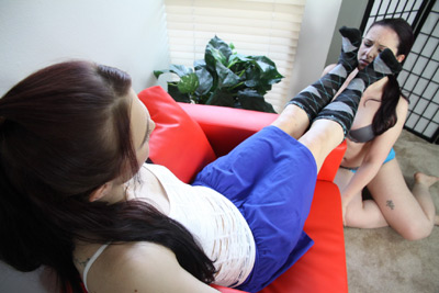 Teasing her slave girl squeezing her face with her socks