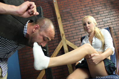 Making the captive suck on her stinky socks