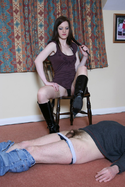 Mistress Zoe points her boot heels at the slave's ball