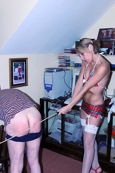 Miss Chloe trains her caning skills on the ass of her victim