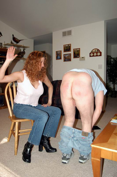 Miss Debbie spanks on the bare ass of her domestic slave