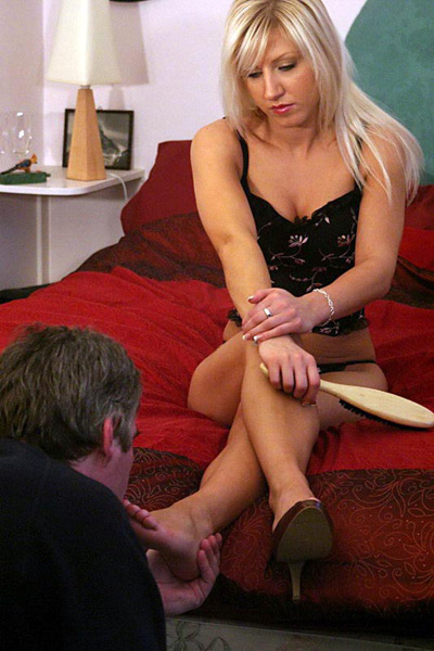 Mistress Vixen's rewards slave with her bare feet