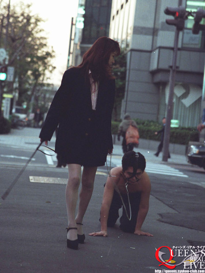 Mistress with her puppy slave at the streets of Japan