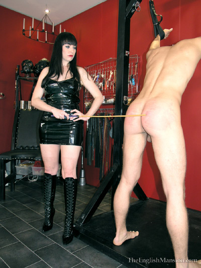 Venting her anger at her slave in the dungeon