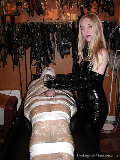 Practicing her mummification skills on her slave