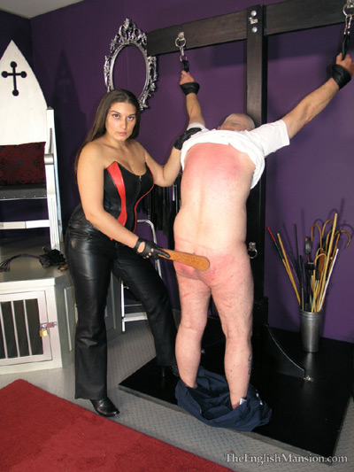 Cuffed up and spanked in the dungeon
