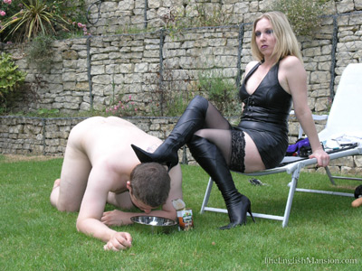 Mistress Sidonia dog feeds her slave outdoors
