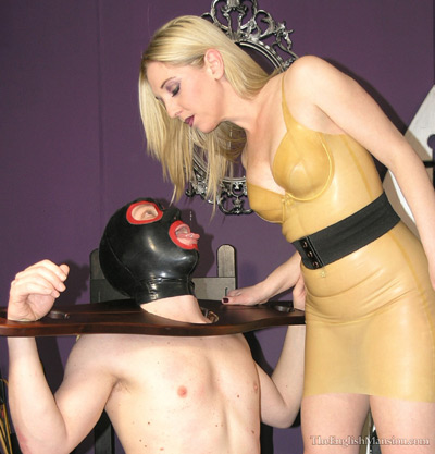Spitting into the mouth of her thirsty slave