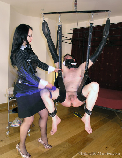 Flogging on the balls of her hung up slave