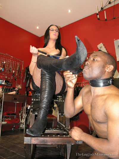 Sucking on the boot heels of his divine Mistress