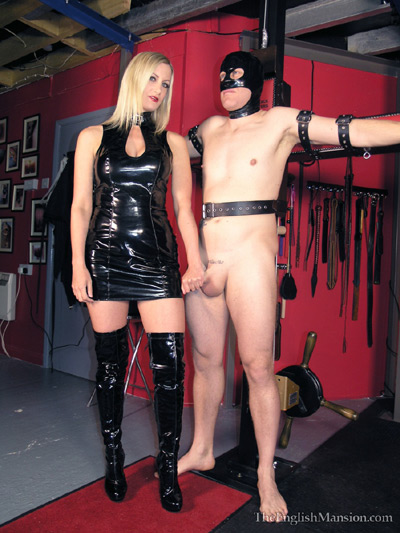 Sadistic Mistress plays with her slave's cock