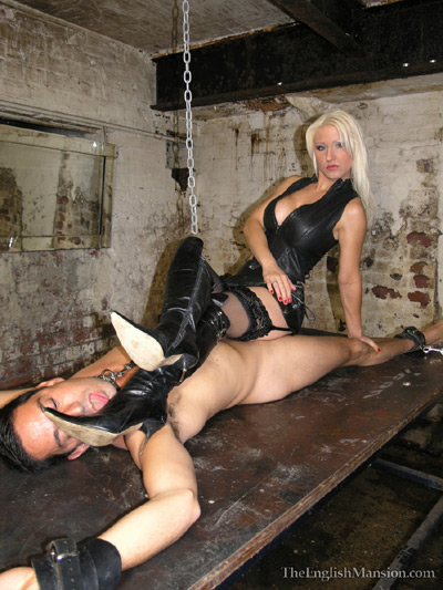 Suspended slave made to lick on her boots