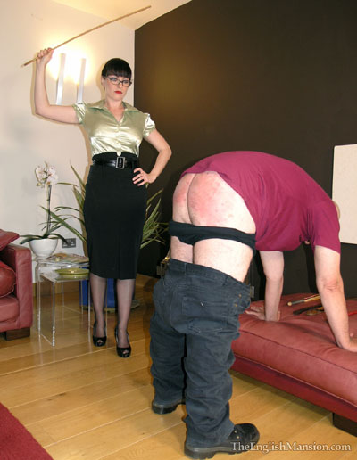 Getting a strict caning by his Mistress