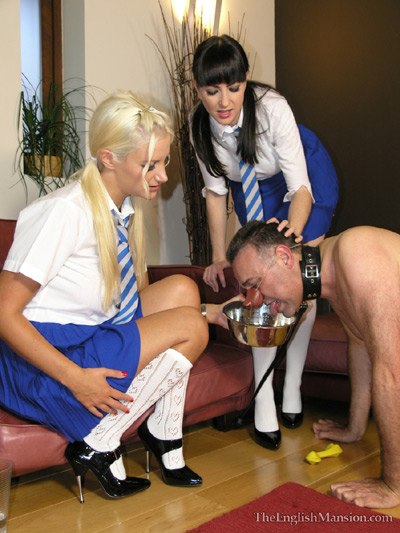 Doggy feeding by his school girl Mistresses