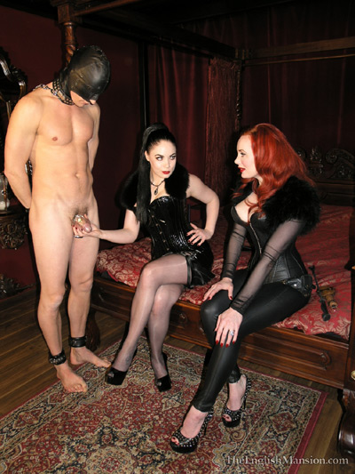 Showing off her chastity skills to a fellow Domme
