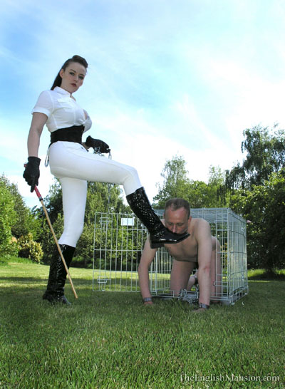 Training her doggy slave to lick boots