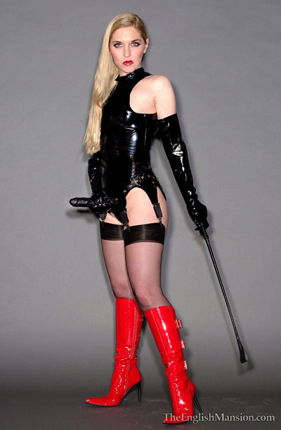 Mistress Sidonia in pvc and strapon
