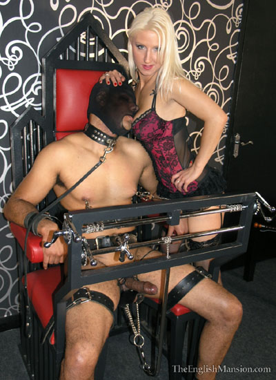 Putting her slave onto the torment chair